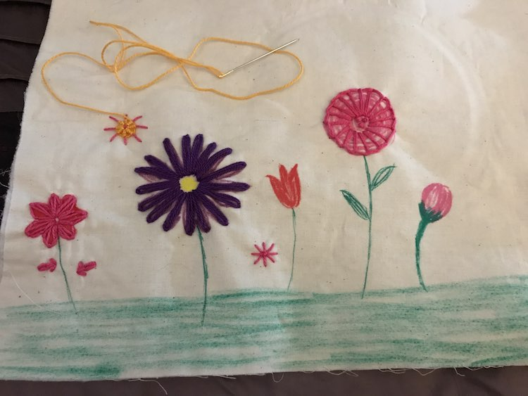 I then added details to the drawn on flowers before going on and adding flowers with only embroidery floss and no background details.
