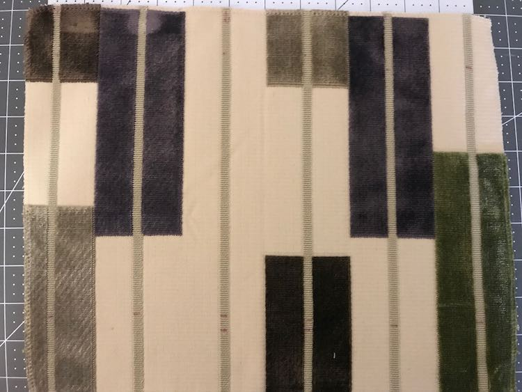 I traced horizontal and vertical lines on the fabric swatch so I would know where to sew to turn the swatch into doors.