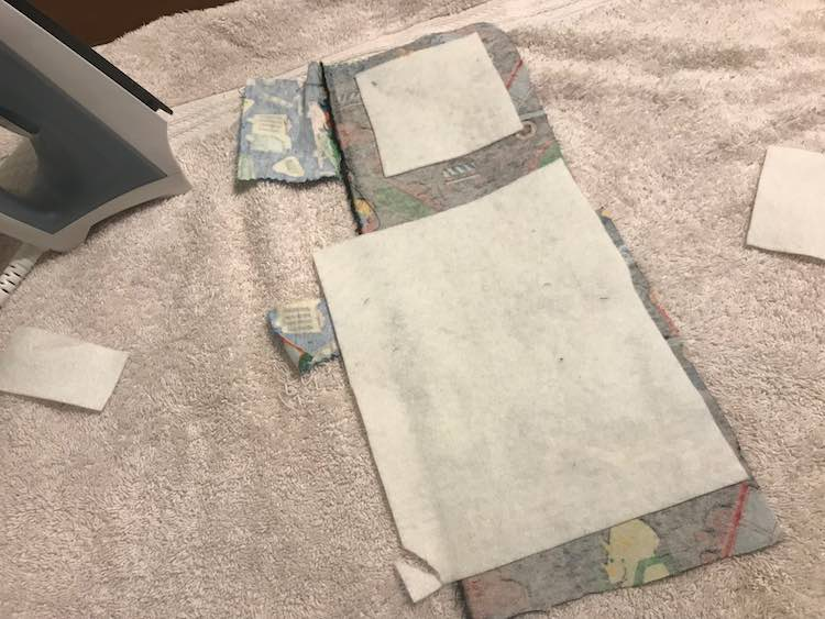 Attached fusible interfacing to the back of the entire back of the fabric where I wanted the patches made from.