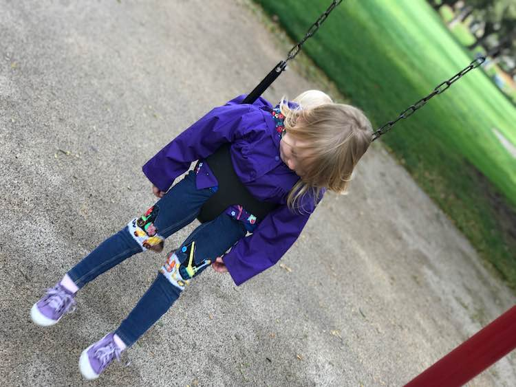 Checking out her pants while swinging.