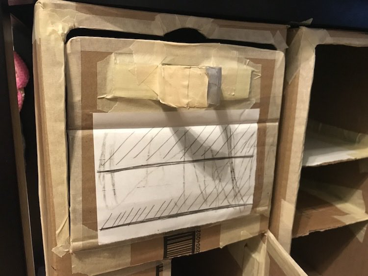 The oven door was cut so it opens from the top down. I added a horizontal handle and drew on a piece of paper before attaching to appear as if the oven light is on.