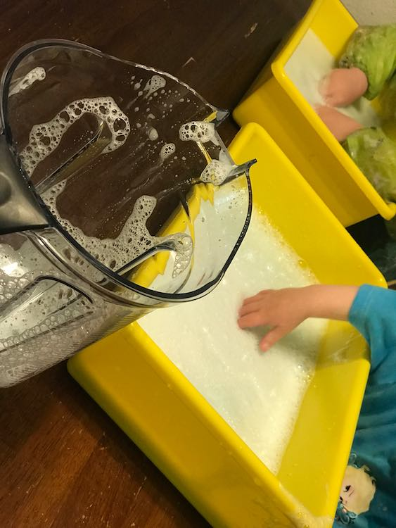 And then pour the tinted bubbles into the sensory bins for bubbly fun.