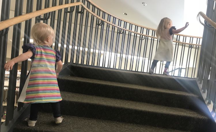 Running up the stairs.