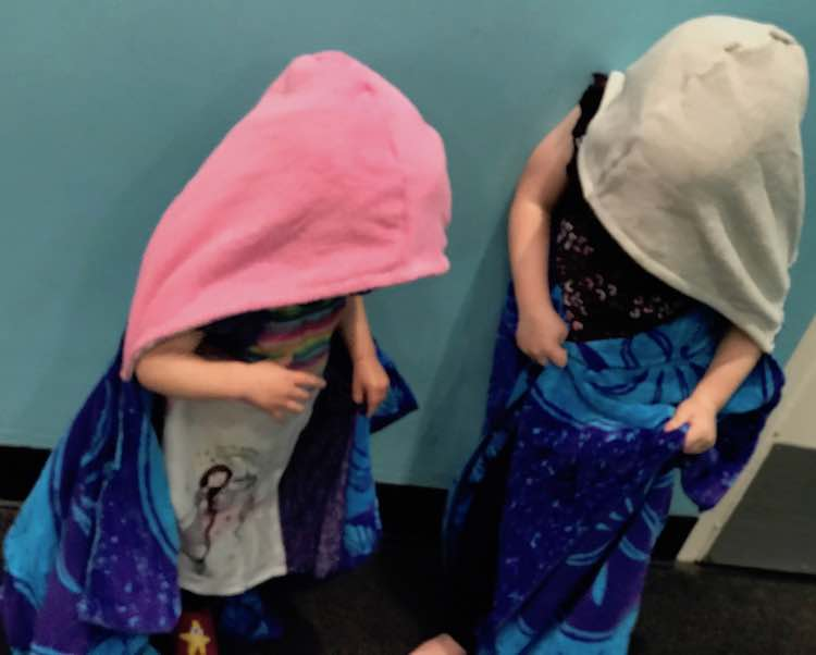 Loving their new towels after getting wet at the discovery museum.