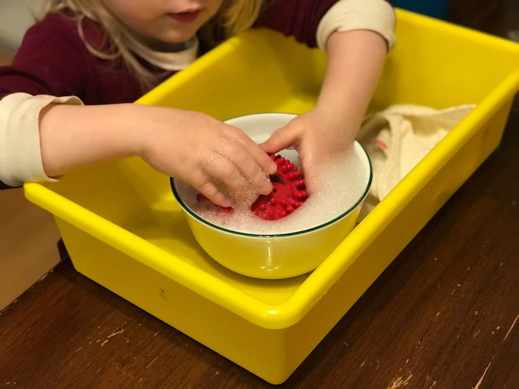 If you want it simpler you could contain it to a single sensory bin and, optionally, keep the soap in a bowl inside it.