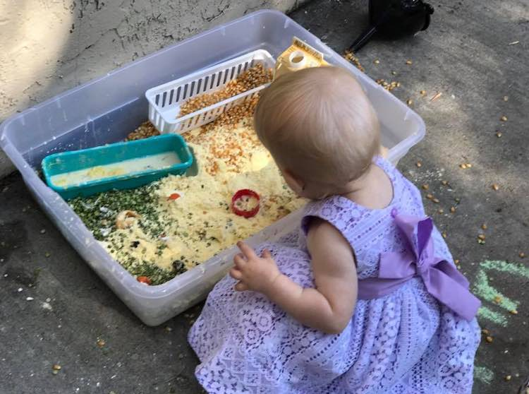 Zoey playing with the sensory bin.
