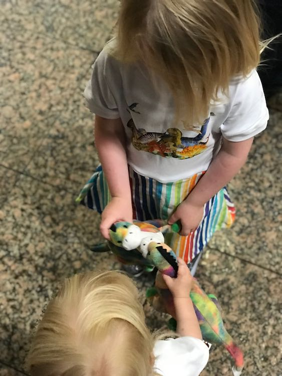My youngest sister joined us and surprised the girls with adorable apotosauruses that happened to match the dinosaur dresses I surprised them with. Here the dinosaurs are kissing.