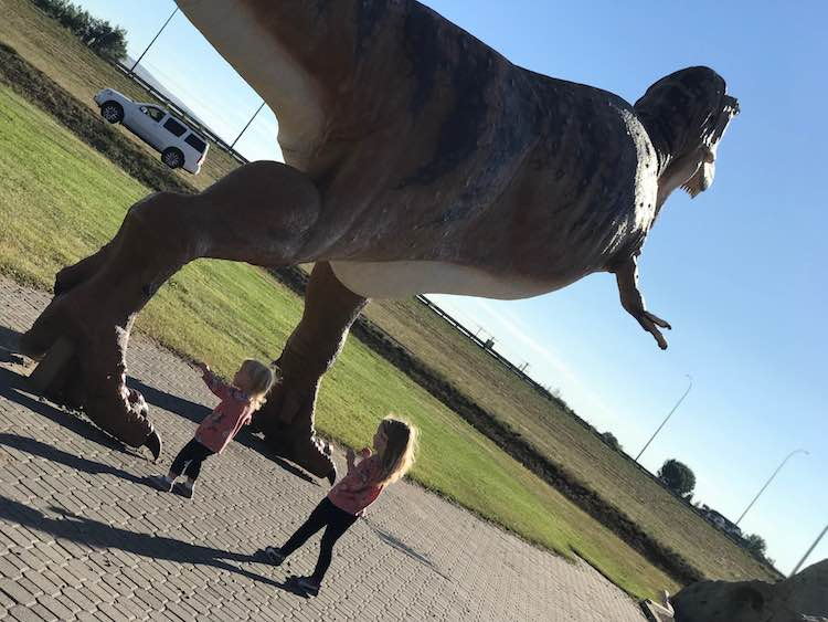 Excited to see their first dinosaur... or to be out of the vehicle.