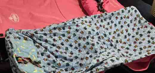 After removing the top blanket, crocheted dolly, and any other items I straightened out the sheets, removed them from their corners, and rolled them up.