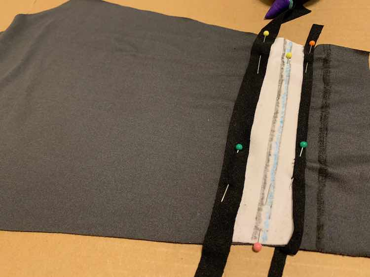 I then took some excess black fabric (from the bodice) to edge the white.