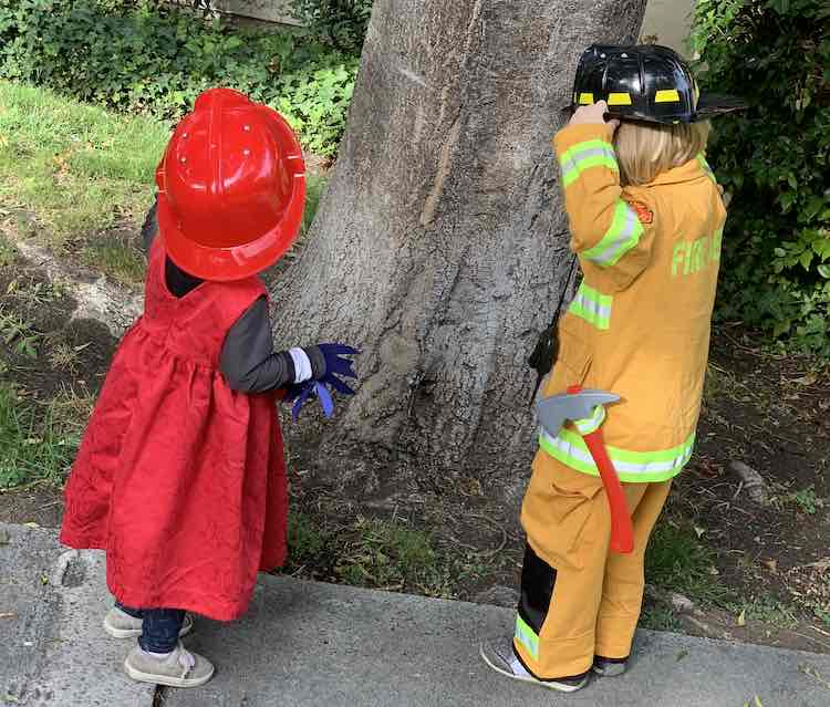 Zoey and Ada dressed up as a firetruck and firefighter.