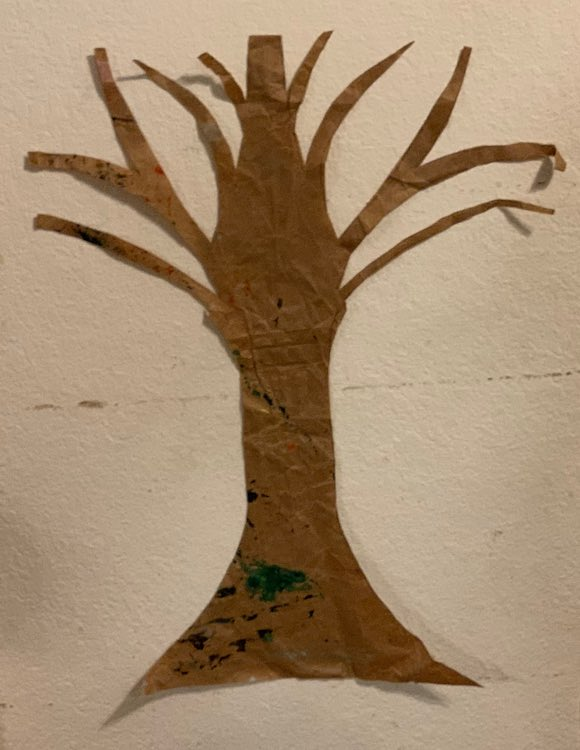 I took small pieces of masking tape and rolled them with the stickiness on the outside to make simple double-sided tape that I wouldn't worry about pulling off the wall later. I attached three along the tree trunk and used smaller pieces near the end of each branch.