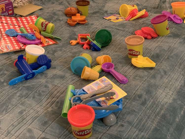 Then seperated the toys into ten piles and matched up one colored container to each pile.