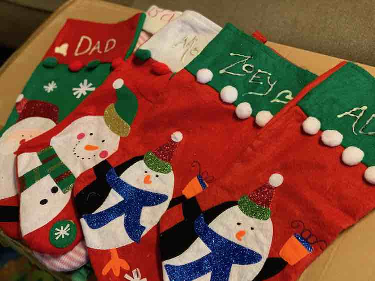 Such a step up from our previous stockings from the Dollar Tree with sharpie and glow paint names.
