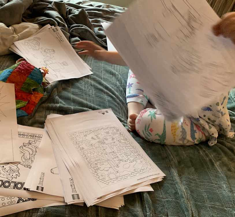 Ada separating the printed coloring pages into an Ada pile and a Zoey pile.