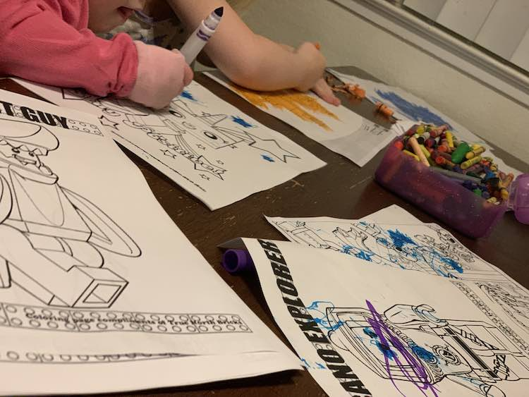 Ada and Zoey coloring their onslaught of new coloring pages.