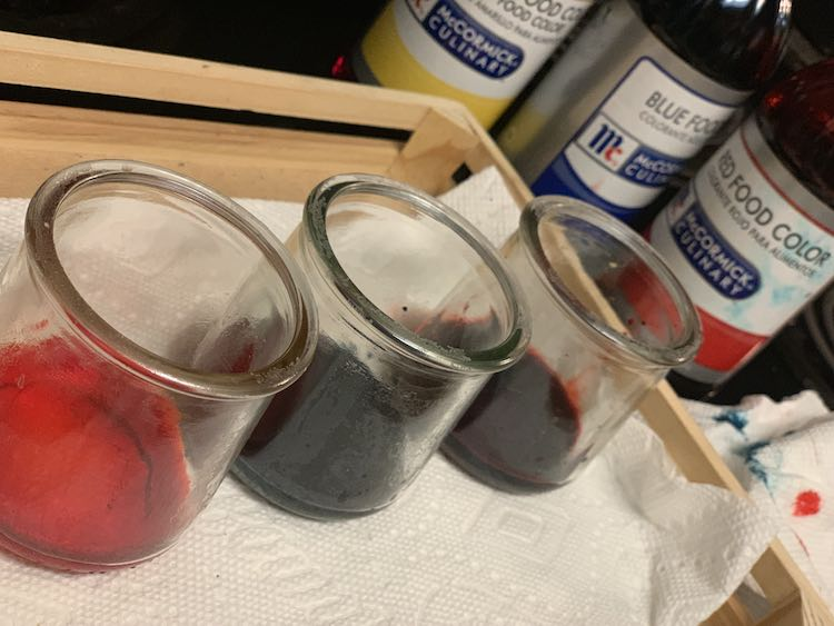 Each jar with a layer of food dye at the bottom.