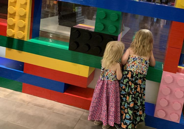 LEGO® dresses by large LEGO® bricks.