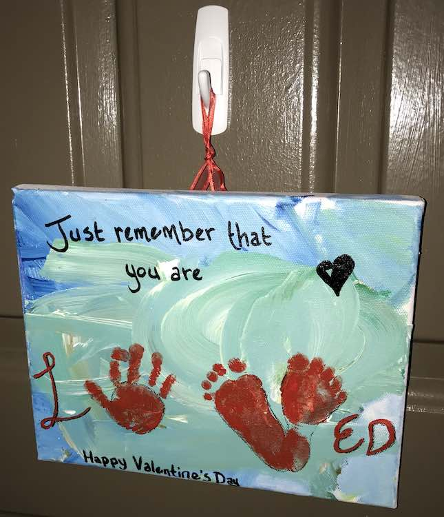 Finished Valentine's Day sign hanging on our door.