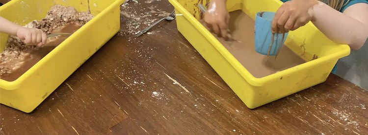Ada loved filling her cup with her runny oobleck while Zoey didn't fully mix her together so had cornstarch islands in her runny muddy oobleck.