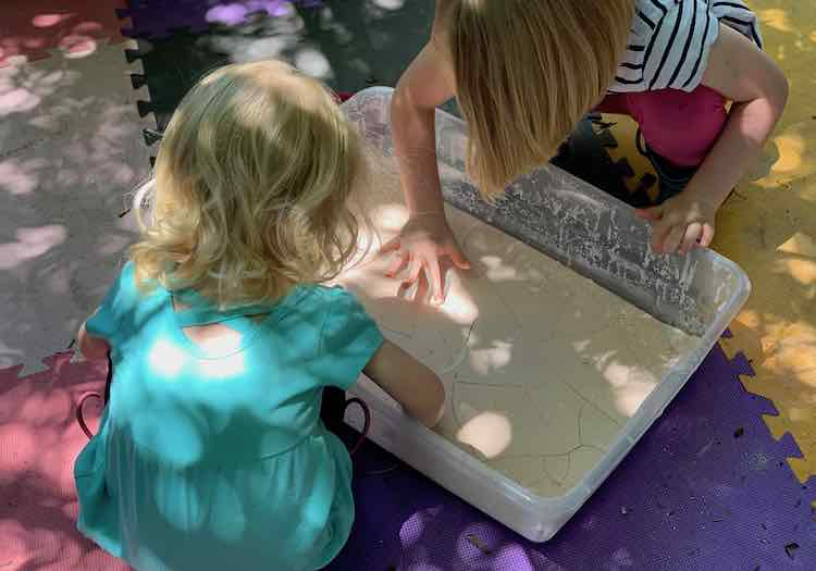 Kids touching the dried oobleck.