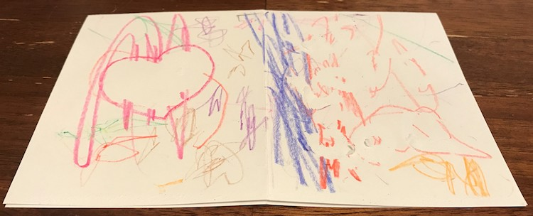 View of the front and back of the card when laid flat (inside down). All the tape has been removed and depending on the surrounding level of coloring the letters range from easy to read (surrounded by colors) to harder (with minimal crayon marks around it).