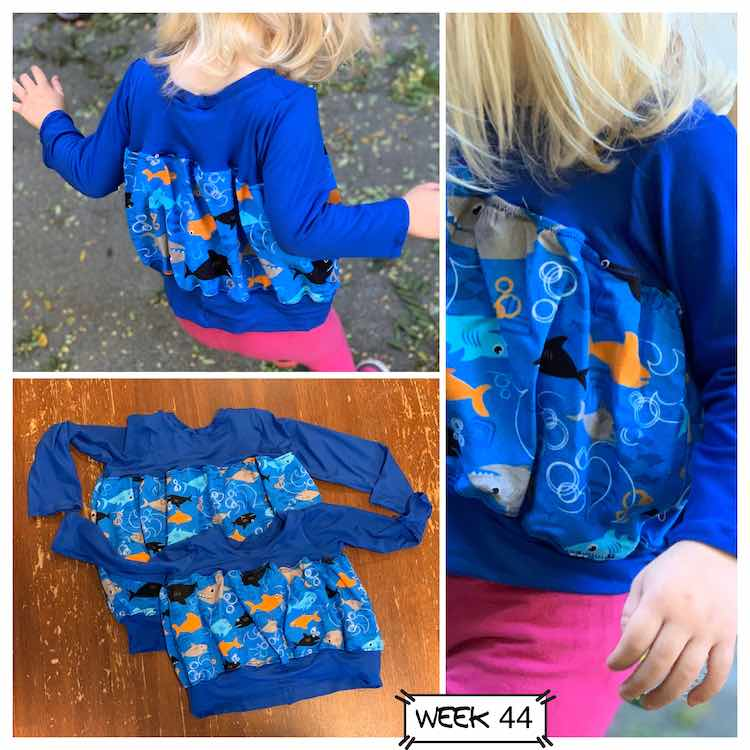 The tulip top was made with blue knit fabric for the sleeves, top, and bottom band. I used shark from for the bubble in the center. The top left photo shows the back of the top, the right photo shows a closeup of the front, and the bottom left photo shows a flat lay of both tops.