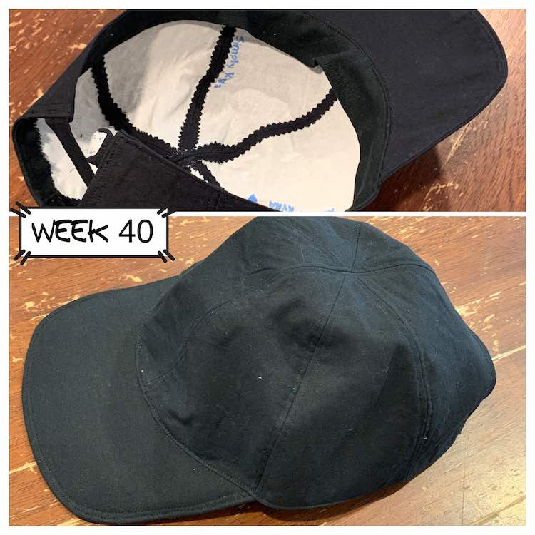 Two views of the finished back baseball cap. The outside is all black and the white inferfacing is showing on the inside. Top image is upside down showing the inside and the bottom image is right side up.