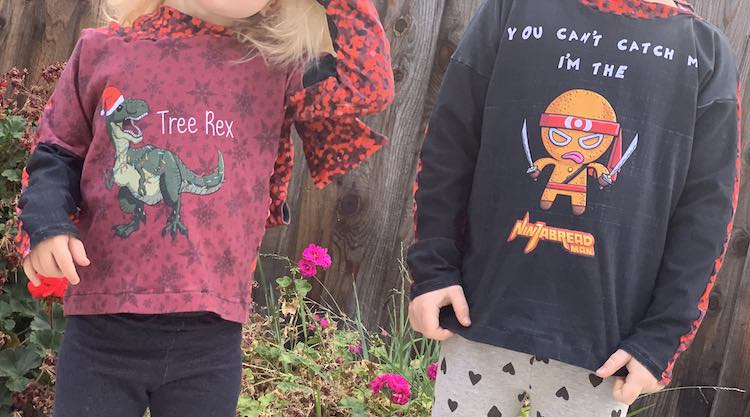 Front view of both Ada and Zoey's shirts. Zoey's is a Tree Rex while Ada's is a NinjaBread Man.