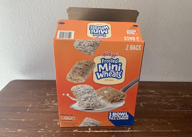 View of the large, double, cereal box emptied and open at the top.