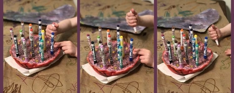 Collage of three views of the felt pen holder as Ada reaches out and grasps the marker (left), pulls it out (center), and draws next to the holder (right).