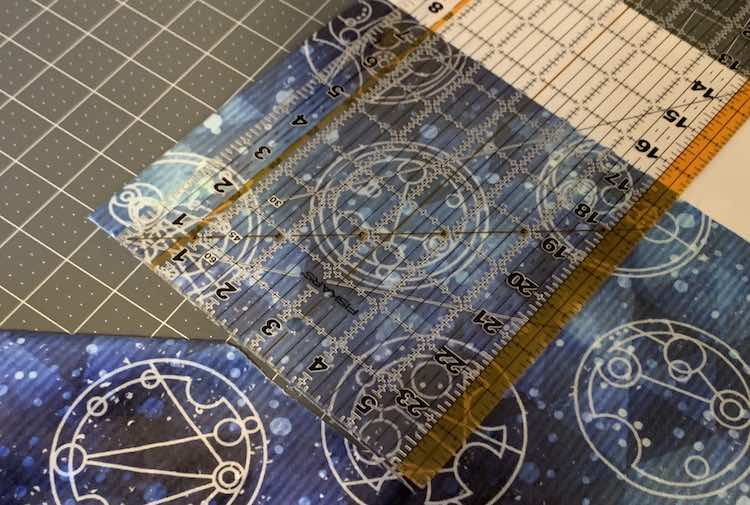 Image showing the corner of the coordinating double plush fabric on a cutting mat with a quilting ruler measuring 7.5 inches from white edge to cut mark.