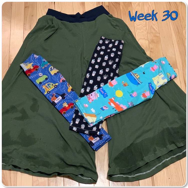 "Image shows an adult sized green and wide-legged pant for me with three pairs of leggings folded and laid out at angles from one another. The leggings are all the same height though the leftmost one is skinnier that the others. Overlaid at the top it says ""week 30""."