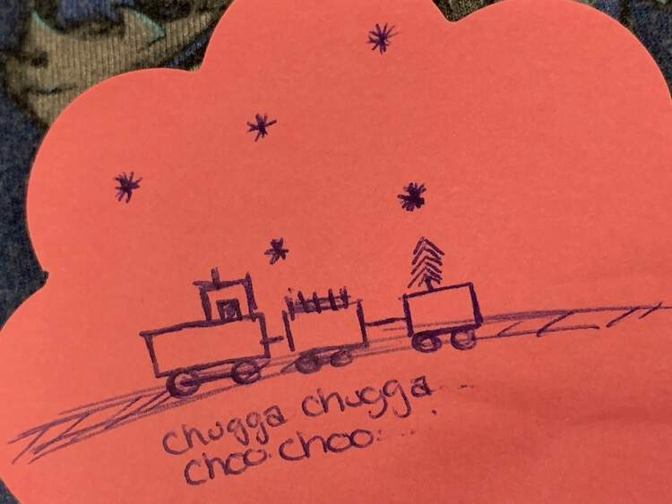 Image shows part of a pink flowered post-it note with a blue inked train on tracks saying 'chug chug Choo Choo' underneath and snowflakes above.
