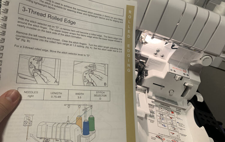 Image shows most of the 3-Thread Rolled Edge page in the baby lock instruction book as the serger, behind it, is opened up.