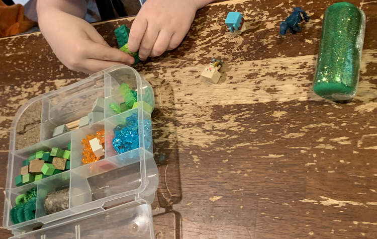 Image shows a Minecraft themed sensory kit with lots of greens, reds, and blues.
