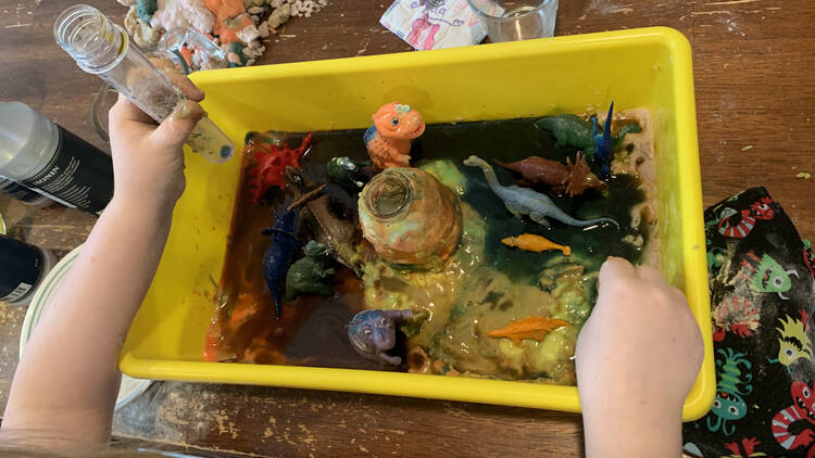 Image shows Ada's bin with some of the playdough areas sliming into the vinegar parts.