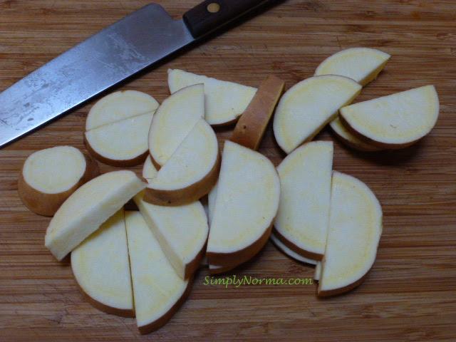 Slice sweet potatoes into quarters
