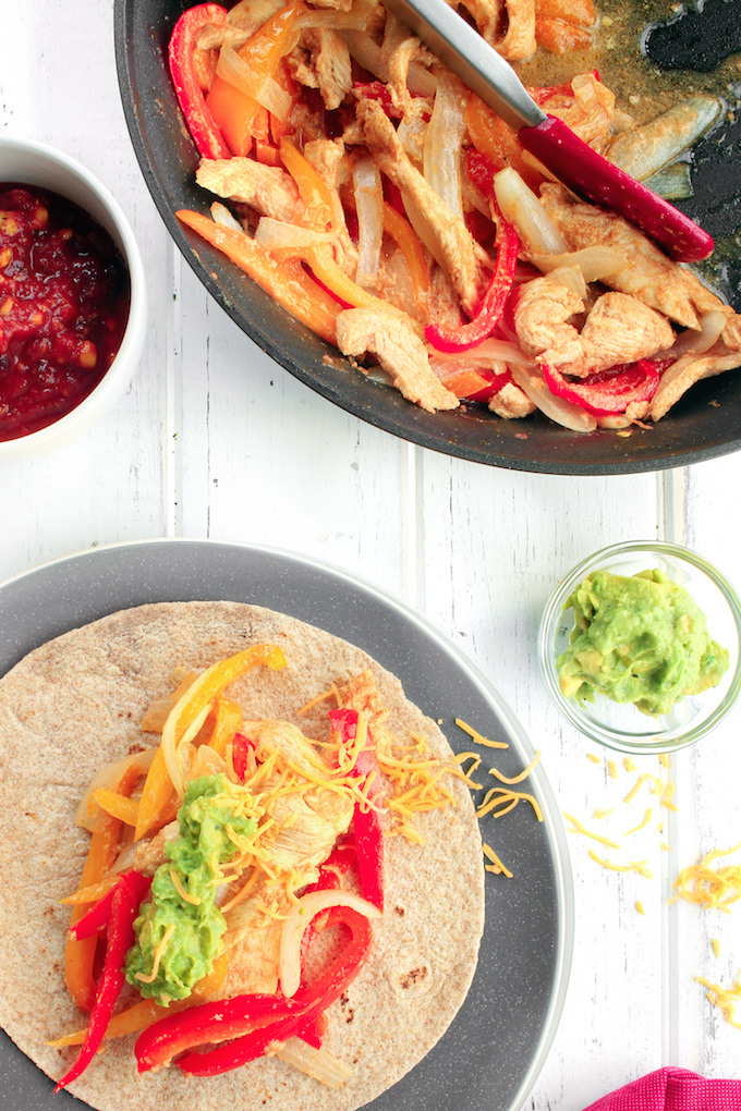 Freezer-Friendly Fajita Kits with marinated chicken, chopped peppers and onions, shredded cheese and whole-wheat tortillas. Top with salsa and guacamole for the ultimate make-ahead Mexican feast.