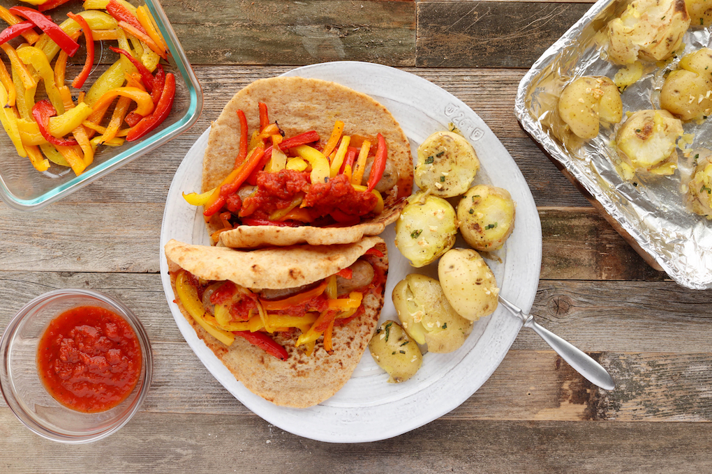 Italian Sausage Gyros are simple to make, requiring just 10 minutes hands on prep. Spicy Italian Chicken Sausage, tender roasted red bell peppers and sweet onions wrapped in a whole-wheat pita with melty mozzarella and marinara, sheet pan supper has never tasted better!