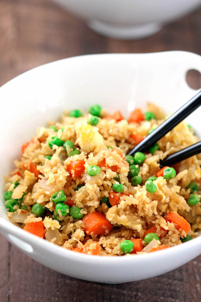 Chicken Fried (Cauliflower) Rice has all the taste and none of the carbs, grains, fat and guilt of ordering takeout!