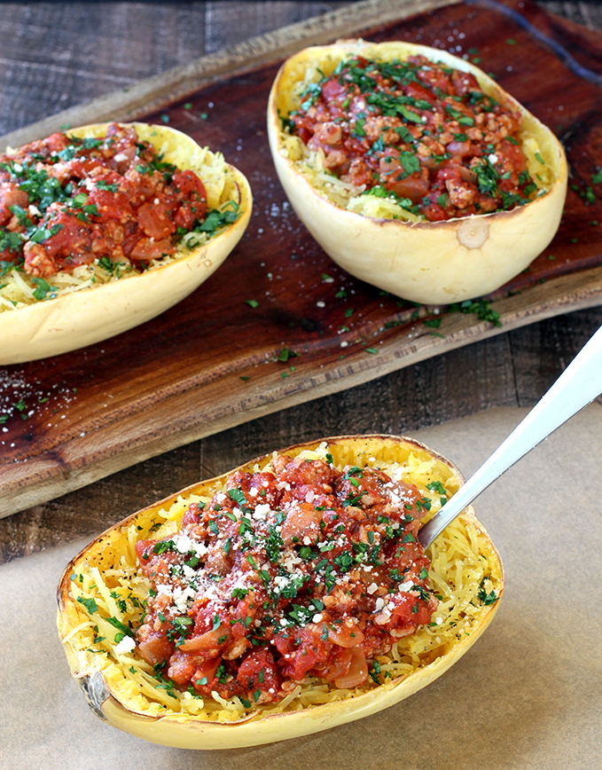 Spaghetti Squash with Healthy Meat Sauce is as satisfying as traditional spaghetti and meatballs without the carbs and calories.