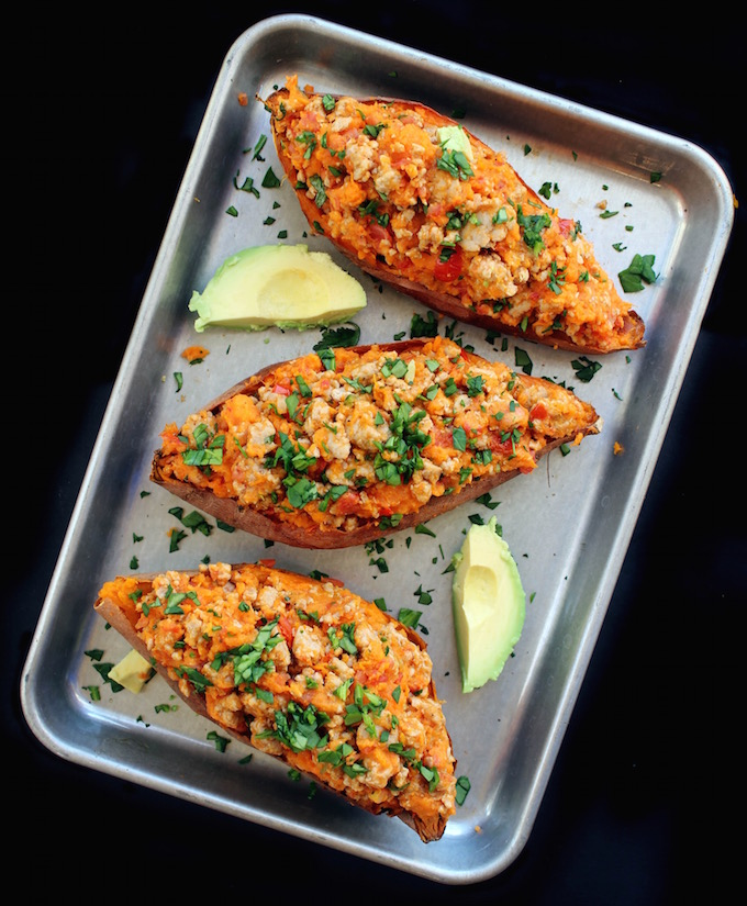 Twice Baked Mexican Sweet Potatoes are gluten/dairy free and  filled to the brim with black beans, seasoned chicken, and spicy pico. Top them with endless amounts of yummy stuff (avocado, melty cheese, sour cream, chunky salsa) and you've got a healthy whole food dinner that comes together in a way that won't disappoint.