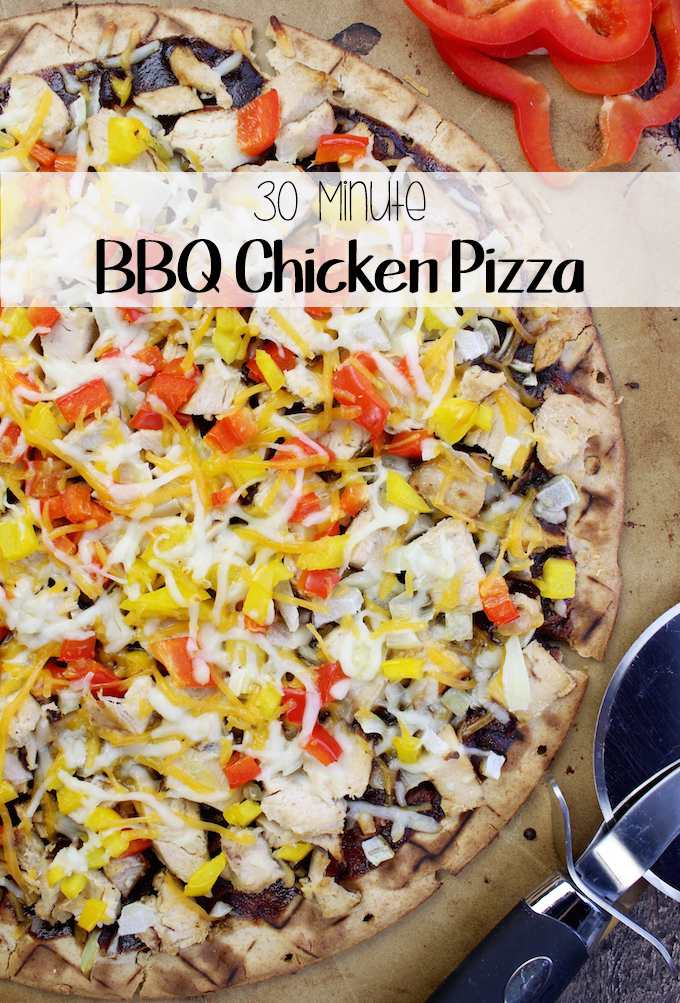 The best and easiest BBQ Chicken Pizza with a whole wheat crust, tangy bbq sauce, loads of seasoned chicken and melty cheeses too!