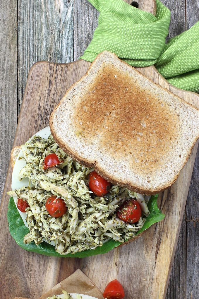 Easy 3 Ingredient chicken salad made with pesto and shredded chicken and made creamy with a dollop of Greek yogurt. A simple, healthy and flavorful twist on a traditional classic.