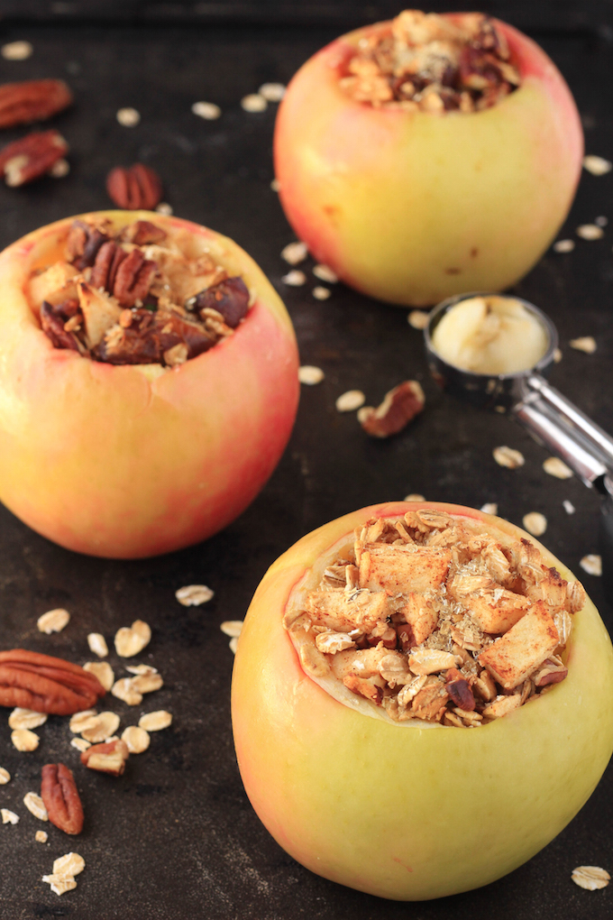 Maple Pecan Stuffed Apples are naturally sweetened and made in 1-bowl. Apples are generously stuffed with oats, pecans, dates and cinnamon, butter, vanilla and cinnamon and then baked until soft and gooey. They make the perfect Fall dessert.