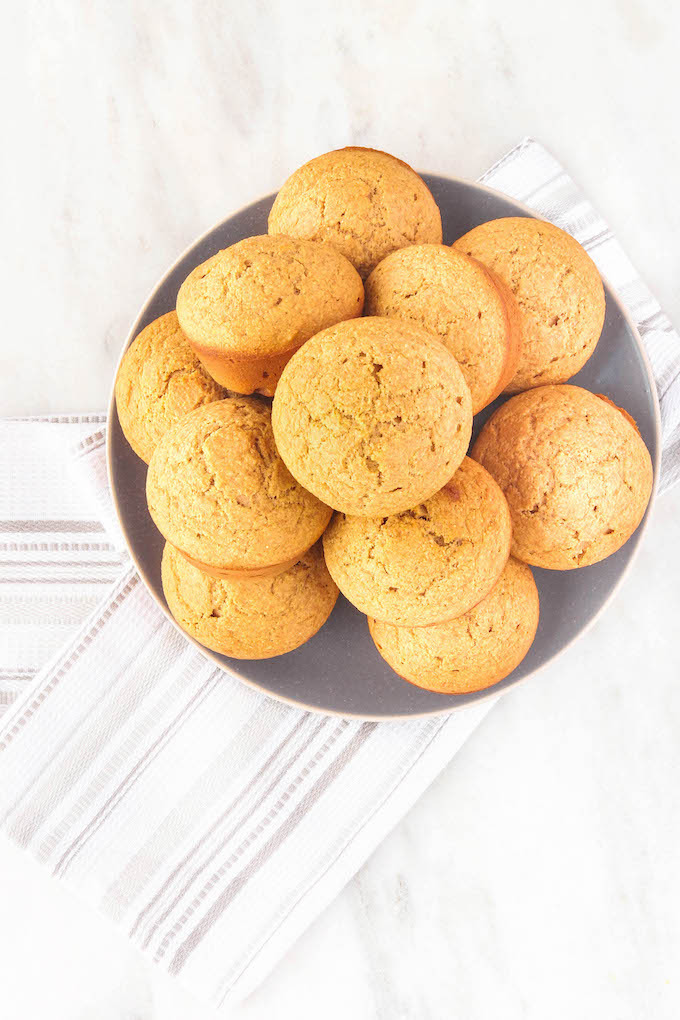 Easy, One-Bowl Corn Muffins sweetened naturally with honey. Tender, wholesome, and a delicious snack or side to savory entrees. #wholegrain