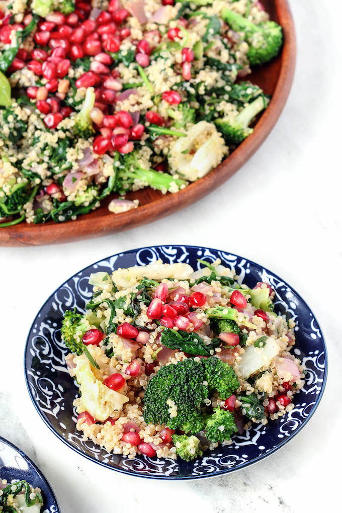 This warm Grains and Greens Detox Salad is simple to throw together and make ahead friendly. With tons of fresh greens, nutty quinoa, pomegranate seeds and a simple lemon vinaigrette..healthy has never tasted better!