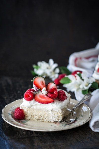 slice of cake with berries on plate