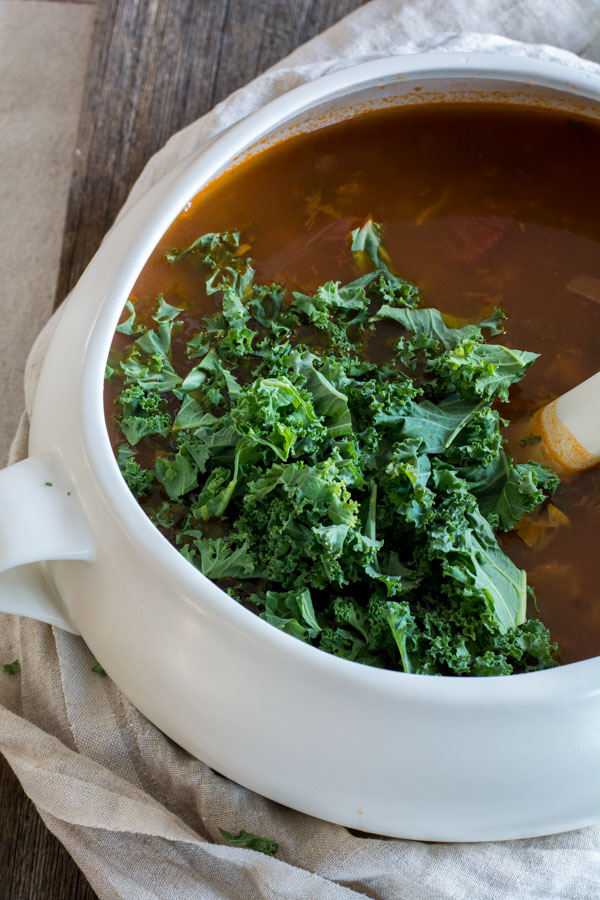 Pot of soup with kale on top